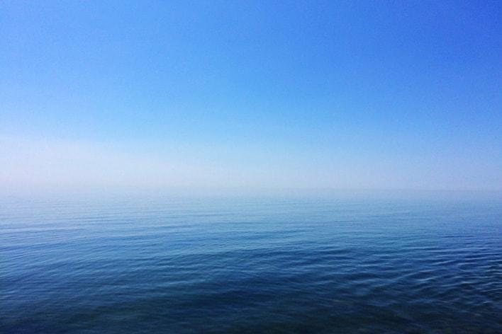 Card image displaying a calm sea.